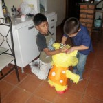 Brayan and Joel filling up the Piñata