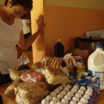 Carol with the food bought for the kids home