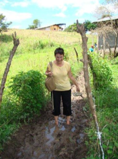 Walking through the mud to get to Raimunda's to check out the new Pulperia.