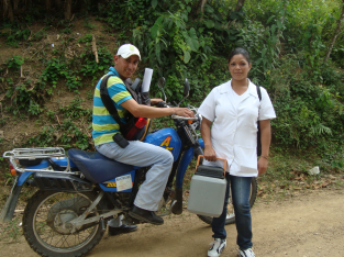 The nurse and health educator on their immunization rounds in Colon