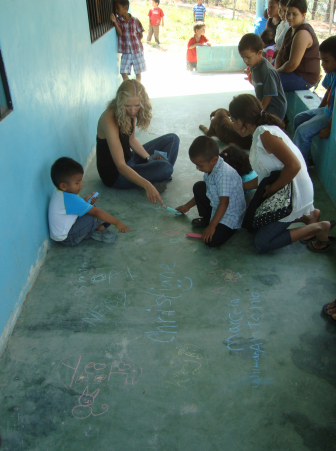 We started the event with each child printing their names on the porch of the school
