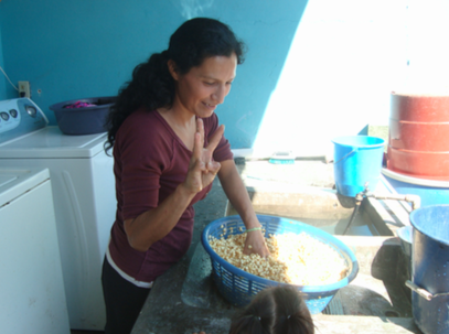 How many tortillas does it take to feed the kids at Casita Copan. This woman and another will finish soaking the corn, grinding the corn and making 300 tortillas.... that would be for each day.